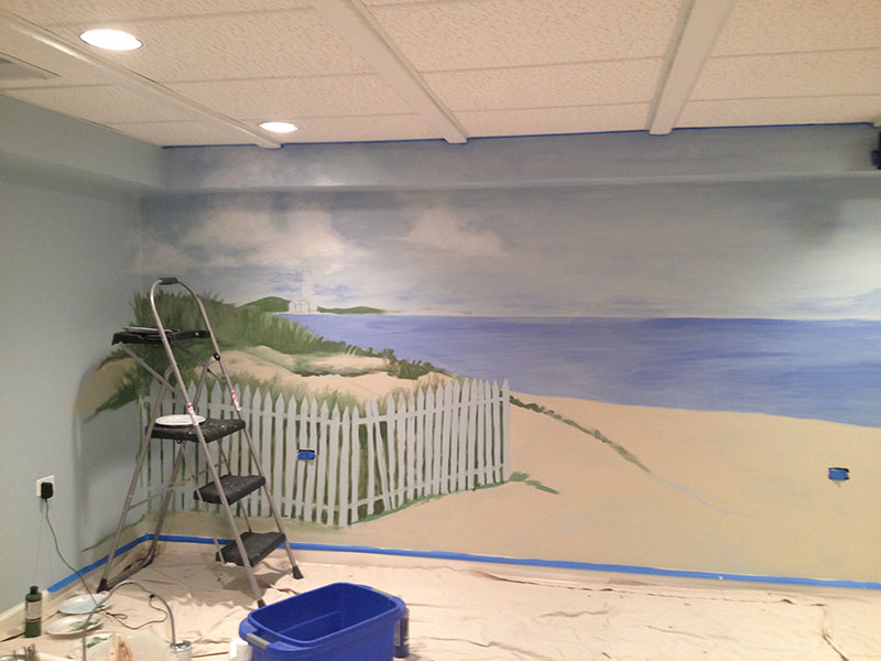 First the mural is laid out on the wall...