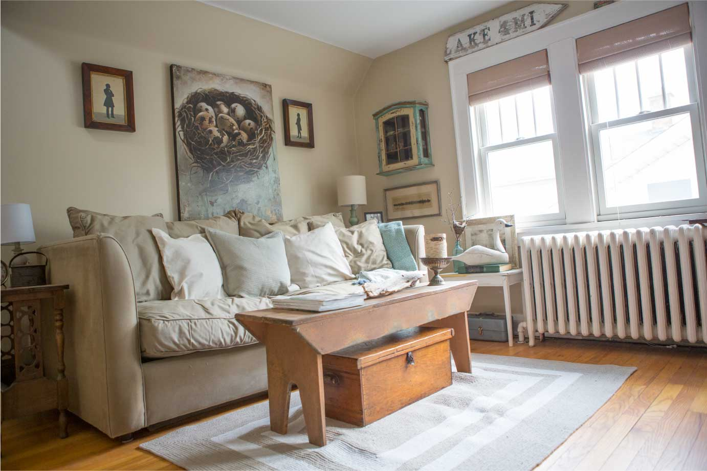 Lots of wood, neutral colors, and nature themed artwork make this room feel inviting.