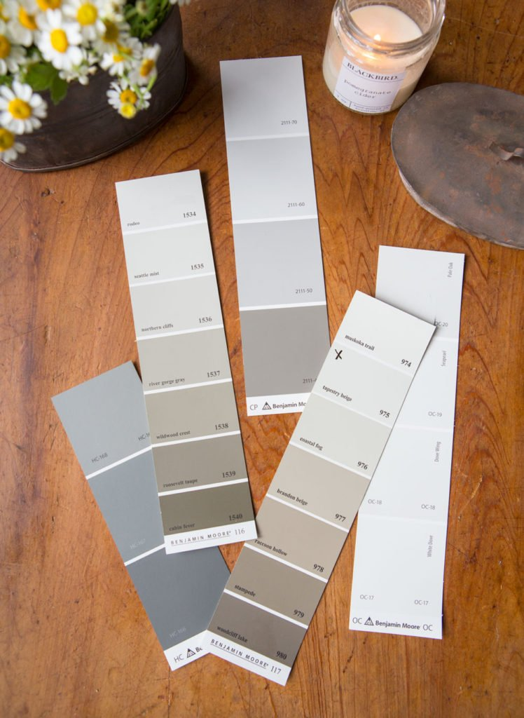 Neutral cool and warm grays and whites create the perfect backdrop for your farmhouse style room.