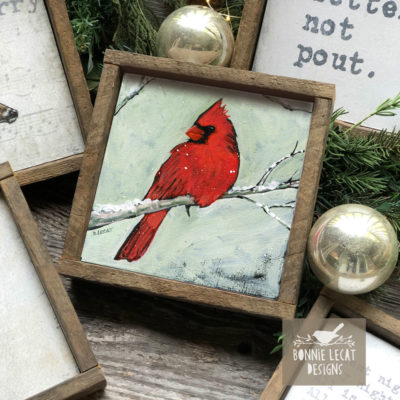 Cardinal art prints in reclaimed wood frames.